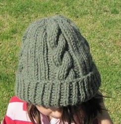 Simple Hat Knitting Pattern In The Round : Easy Ribbed Cable Hat AllFreeKnitting.com