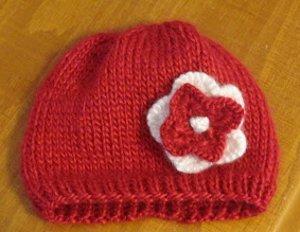Knitting Pattern For Beanie With Flower : Stockinette Flower Baby Beanie AllFreeKnitting.com