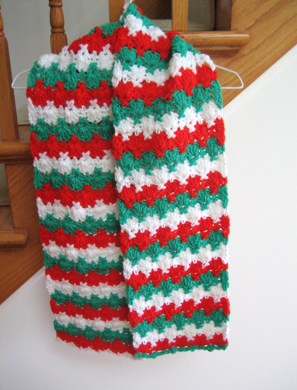 Free Crochet Patterns For Christmas Scarves : Holiday Criss Cross Crocheted Scarf Pattern FaveCrafts.com