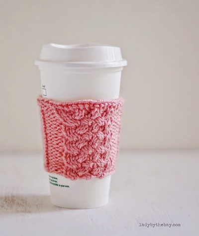Mug Cozies Knitting Pattern : Too Cute Cabled Mug Cozy Knitting Pattern AllFreeKnitting.com