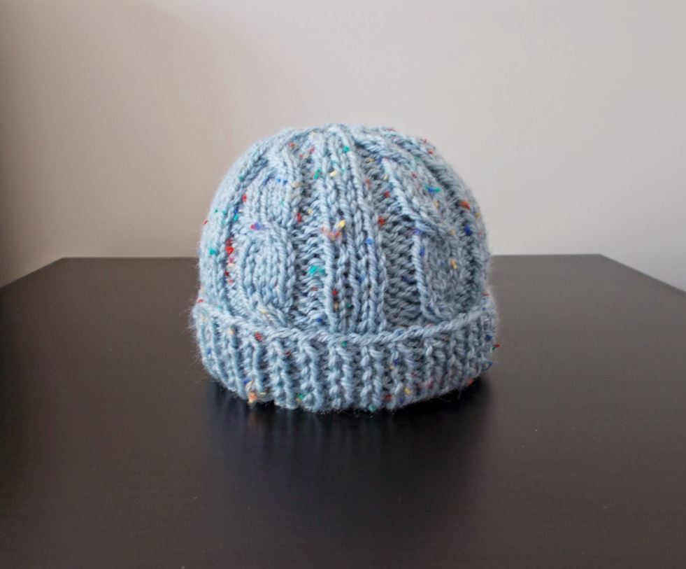 Beginner Hat Knitting Patterns : Birthday Cake Knit Baby Hat AllFreeKnitting.com