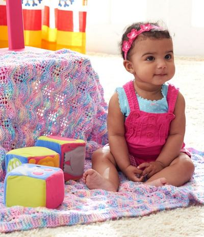 Knitting Pattern Rainbow Baby Blanket : Rippling Rainbow Knit Baby Blanket AllFreeKnitting.com