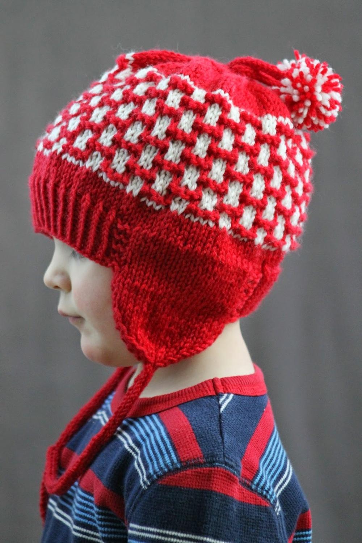 Earflap Hat Knitting Pattern Bulky Yarn : Pom-Pom-Earflap-Hat_ExtraLarge1000_ID-1015744.jpg?v=1015744