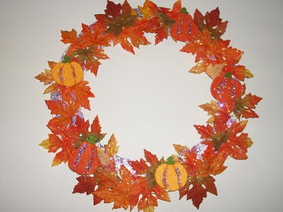 http://d2droglu4qf8st.cloudfront.net/2015/08/232718/Glitter-Leaves-and-Felt-Pumpkin-Wreath_Large400_ID-1143983.jpg?v=1143983