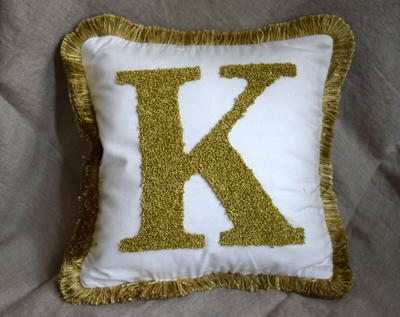 http://d2droglu4qf8st.cloudfront.net/2015/09/236653/DIY-Monogram-Letter-Pillow_Large400_ID-1191577.jpg?v=1191577
