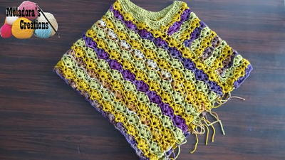 http://d2droglu4qf8st.cloudfront.net/2016/02/252942/Winsome-Crochet-Poncho-Pattern_ArticleImage-CategoryPage_ID-1385536.jpg?v=1385536