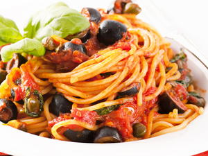Fiery Spaghetti with Anchovies, Olives, and Capers in a Quick Tomato Sauce