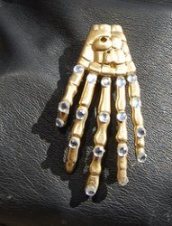 Bejeweled Skeleton Hand Brooch