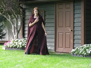 Merlot hooded cape allfreeknitting let your sorcerous side shine through with the merlot hooded cape bewitching and mysterious this knit cape pattern is perfect outfit for a clandestine dt1010fo