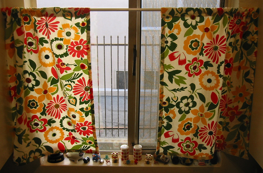 Of course I won't have the flowers embroidered on my curtains, but do you  think that this would work in my 1940s kitchen of today?