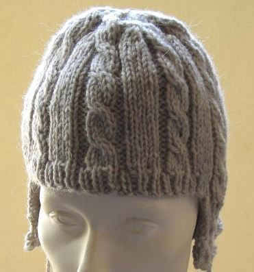 Cable Ear Flap Hat with Pom Poms | AllFreeKnitting.com