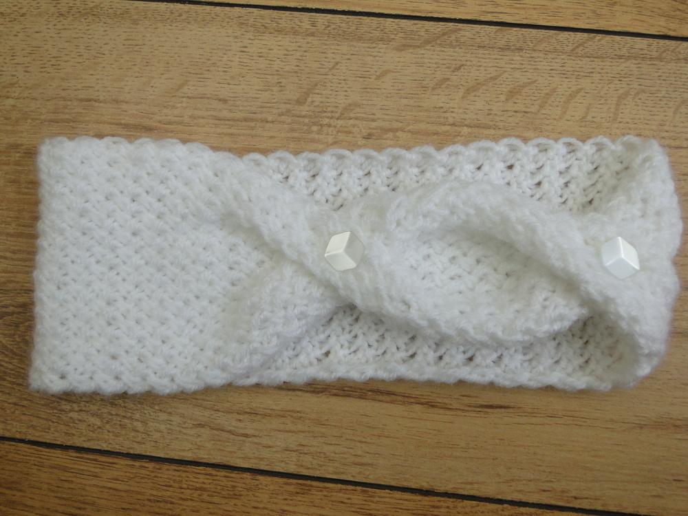 Free Knitting Pattern Twisted Headband : Fashionably Twisted Knit Headband AllFreeKnitting.com