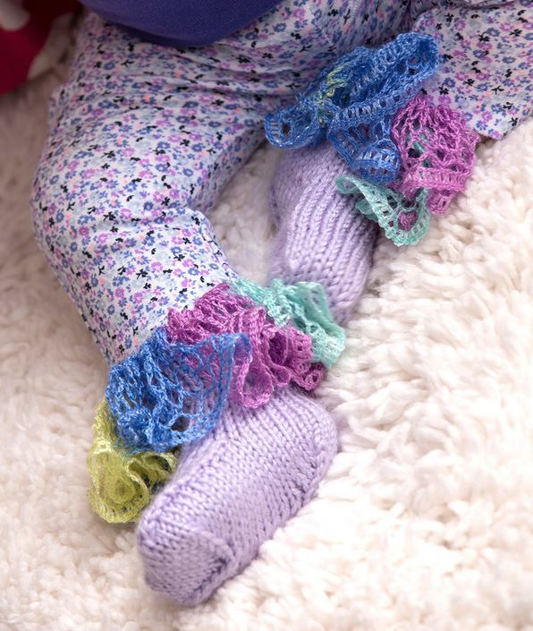 Knitting Pattern For Ruffle Baby Vest : Wildflower Ruffle Baby Booties AllFreeKnitting.com