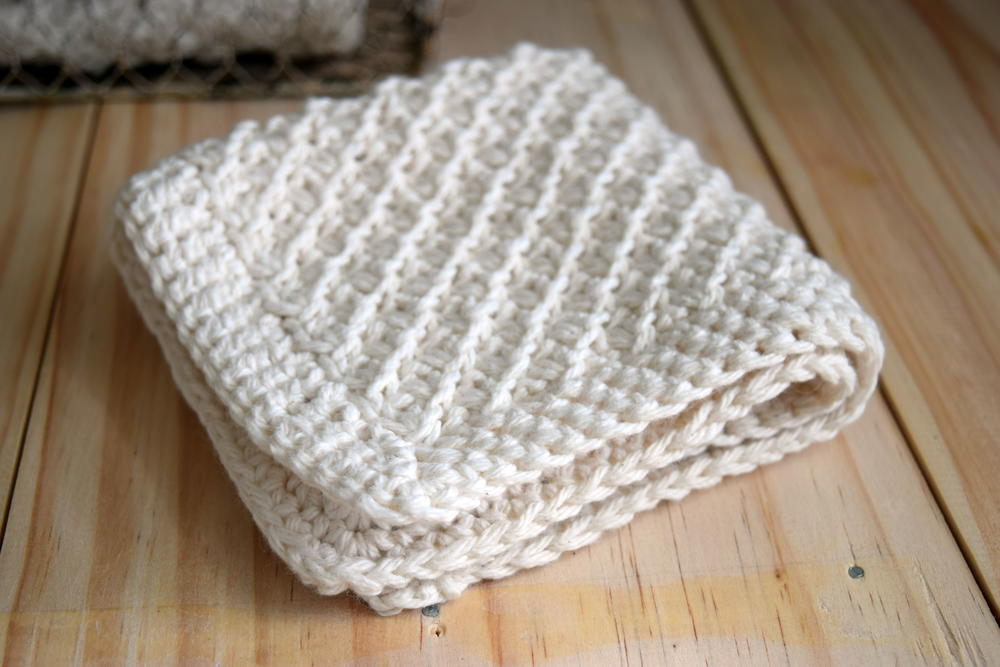 How To Knit Dishcloths Free Patterns : Daisy Stitch Washcloth Knitting Pattern FaveCrafts.com