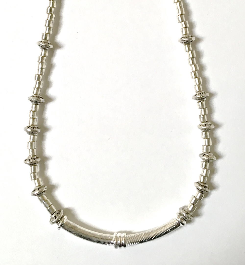 Seductive Silver Curve Necklace | AllFreeJewelryMaking.com