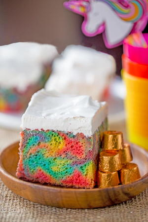 Rainbow Poke Cake with Whipped Cream