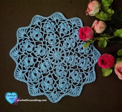 13 free crochet doily patterns for beginners favecrafts flower wheel doily a floral crochet motif repeated over and over spins out into this stunning crochet doily ccuart Gallery