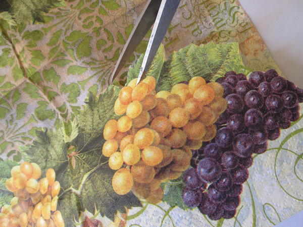 Cut grape  and leaf images (or images of your choice) from the paper napkin, making sure to cut through both layers.
