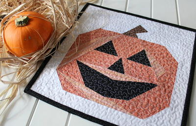 19 Pumpkin Patterns: Free Tutorials for Fall Quilts | FaveQuilts.com : pumpkin quilt patterns - Adamdwight.com