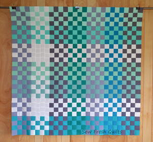 Teal Appeal 16 Patch Quilt